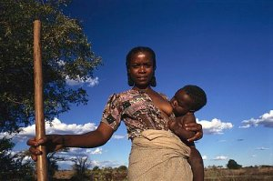 Woman Breast Feeding Her Child